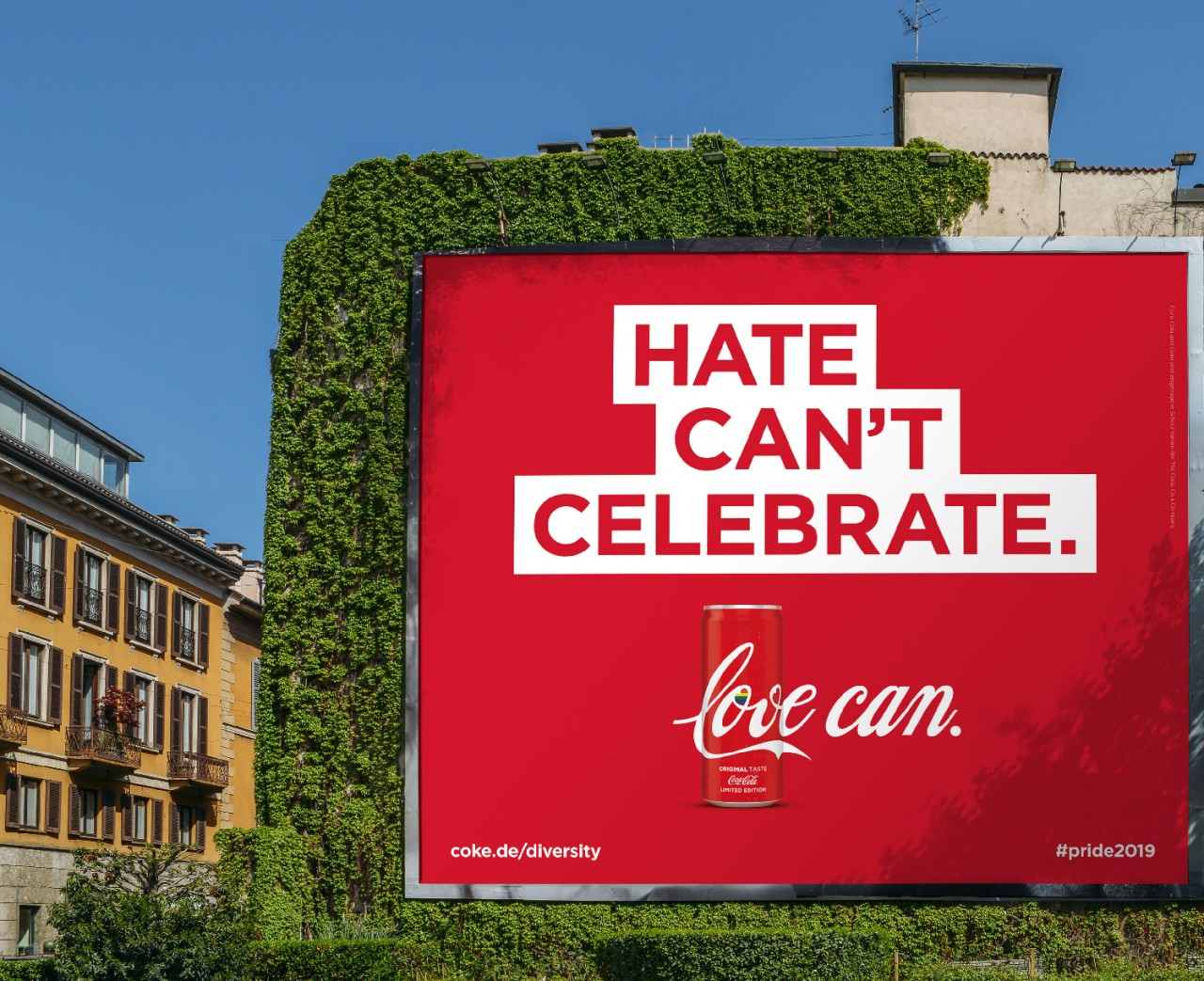 A Coca-Cola Company's banner displayed in a city displaying how hate cannot celebrate, but love can to stimulate diversity and inclusion